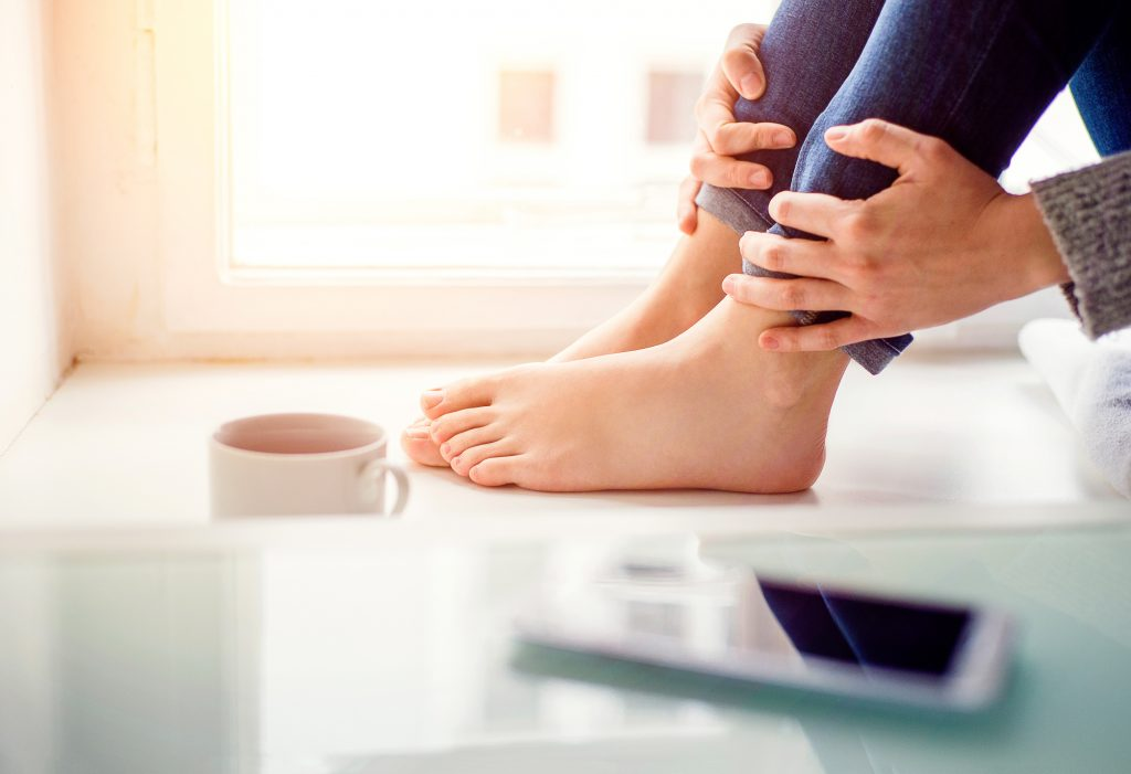Person With Flat Feet Sitting On Floor