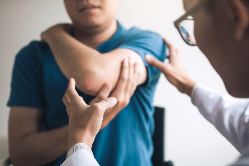 Physical Therapist Checking Patients Elbow